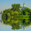 Christian church near a lake — Stock Photo #57071637