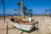 Small elegant boat on a beach — Stock Photo