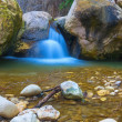 Small waterfall on a mountain river — Stock Photo #75948627