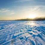 Winter snowbound plain at the sunset — Stock Photo #78468486