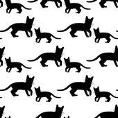 Seamless pattern with black cats on white — Stock Vector