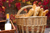 Baskets with wine and bread  — Stock Photo
