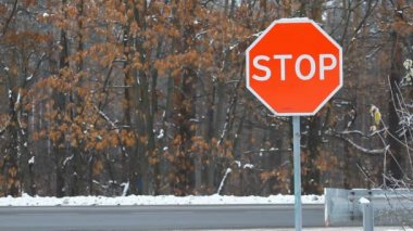 Stop sign on a highway — Stok video