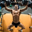 Постер, плакат: Bodybuilder with dumbbells