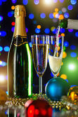 Champagne and Christmas balls — Stock Photo