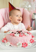 Baby with birthday cake — Stock Photo