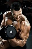 Bodybuilder  with  dumbbell — Stock Photo