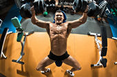 Bodybuilder with dumbbells — Stock Photo