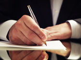 Businessman signing up contract — Stock Photo