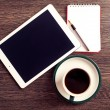 Tablet with paper and coffee — Stock Photo #56040883