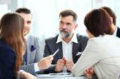 Business partners discussing documents and ideas — Stock Photo