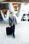 Businessman rushing in airport — Stock Photo