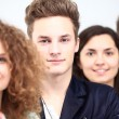 Happy Smiling Students Standing In Row — Stock Photo #62779691