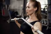 Woman exercising building muscles — Stock Photo