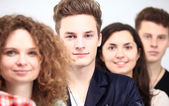 Happy Smiling Students Standing In Row — Stock Photo