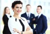 Face of beautiful woman on the background of business people — Stock Photo