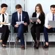 Business people waiting for job interview. Four candidates compe — Stock Photo #73461563
