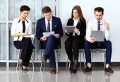 Business people waiting for job interview. Four candidates compe — Stock Photo