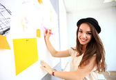 Woman writing on board with notes — Stock Photo