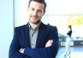 Happy smart business man with team mates discussing in the backg — Stock Photo