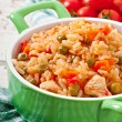 Постер, плакат: Pilaf with chicken carrot and green peas