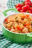 Pilaf with chicken, carrot and green peas — Stock Photo