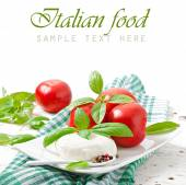 Background with Mozzarella, tomatoes and fresh basil leaves — Stock Photo