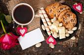 Cup of coffee with chocolate and cookies — Stock Photo