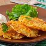 Potato pancakes with sour cream — Stock Photo #56209701
