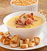 Cream soup of peas with fried bacon and croutons — Stock Photo