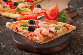 Pizza with shrimps and salmon — Stock Photo