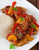 Meat with a garnish of boiled rice — Stock Photo