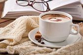 Cup of latte with book and glasses — Stock Photo
