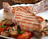 Juicy grilled pork steaks on the bone — Stock Photo