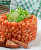 Baked beans with tomato sauce — Stock Photo