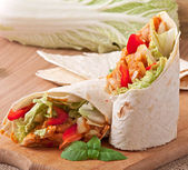 Burrito with chicken, beans, tomatoes and sweet peppers — Stock Photo