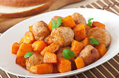 Chicken meatballs with a garnish — Stock Photo