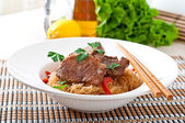 Pork medallions with noodles — Stock Photo