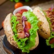 Hot dogs with sausages and vegetables — Stock Photo #70847085