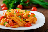 Penne pasta in tomato sauce — Stock Photo