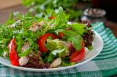 Salad with arugula, chicken, lettuce, red pepper — Stock Photo