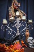 Spider, autumn oak leaves, chandelier, totem skull and vampire — Stock Photo