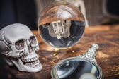 Skull, old mirror and crystal ball with reflection skeleton — Foto de Stock