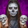 Young woman in day of the dead mask skull face art with two skul — Stock Photo #55759485