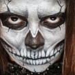 Young woman in day of the dead mask skull face art. — Stock Photo #55759509