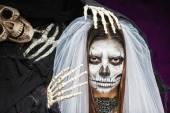 Young woman a bride in a veil day of the dead mask skull face ar — Stockfoto