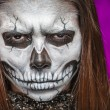 Young woman in day of the dead mask skull face art. — Stock Photo #55760385