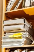 Stack of paper in bookcase — Stock Photo