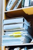 Stack of paper in bookcase — Foto Stock