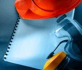 Goggles, earphones and red helmet — Stock Photo